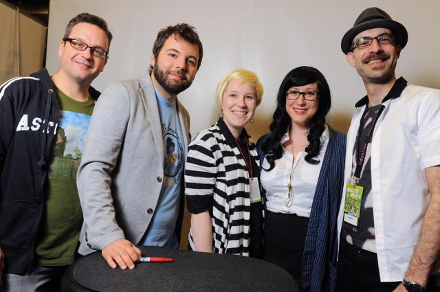 Me (a la gender-swapped Sherlock Holmes, sadly without my riding crop and persian slipper stuffed with tobacco), one of my con buddies, and the Welcome to Night Vale Crew!